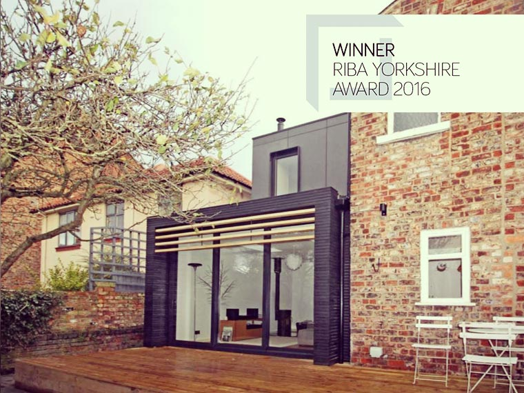 Carter Grice project wins RIBA awards 2016 featuring winning house with back garden, modern decking and large glass living room windows