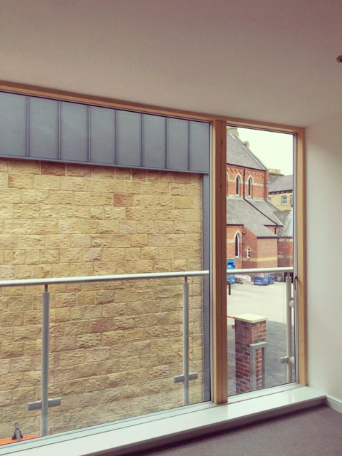 Carter Grice Project - Modern interior looking out of balcony window in new Harrogate city development