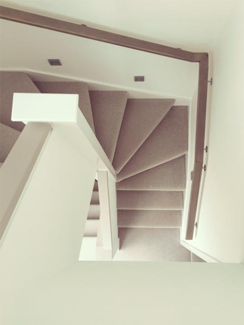 Carter Grice Project - Modern interior looking down elegant stairwell in new Harrogate city development