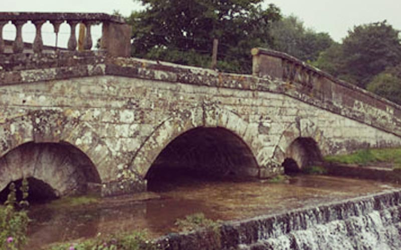 Carter Grice restoration and stonework repair project showing old stone bridge on Hovingham Hall estate.
