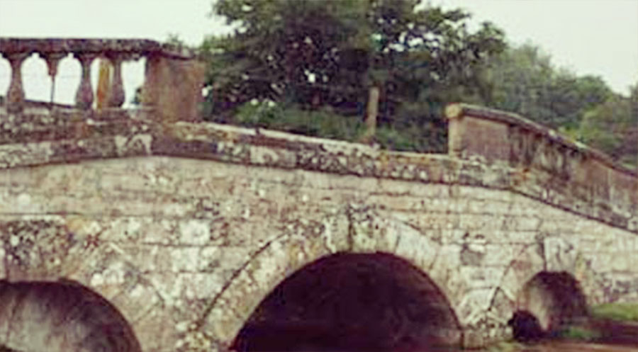 Carter Grice restoration and repair on stonework service featuring old stone bridge